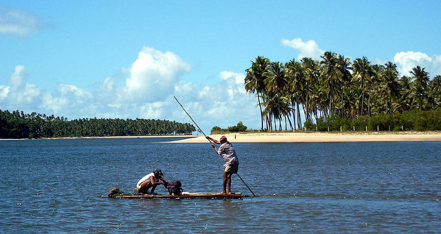 Fishermen at freshwater stream
